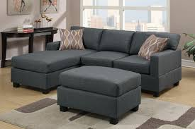 cozy cool looking dark gray sectional sofa with dark grey square coffeetable on brown rug on