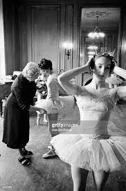 Ballet teacher Marjorie Middleton arranging a student's skirt while... News  Photo - Getty Images