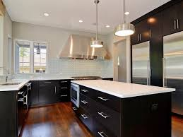 Kitchen With Black Cabinets, White Countertops & Stainless Appliances