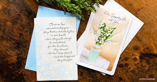 sympathy greeting cards on a wood table