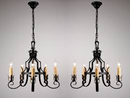 sold two matching antique five light wrought iron chandeliers c 1920 s