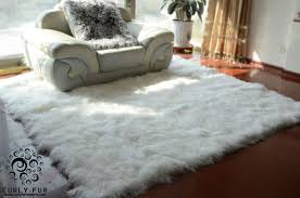 white fur rug with cozy daybed and wooden
