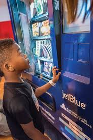 Kid In Vending Machine Interesting JetBlue's 'Soar With Reading' Vending Machines Deliver Free Books To