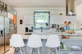 an architect wanted to showcase the cabinets metal skeleton his wife craved a e that s light airy and organic here s how their desires came together