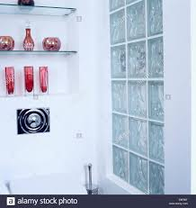 ideas collection of colorful glassware on glass shelves in alcove beside in size 1300 x