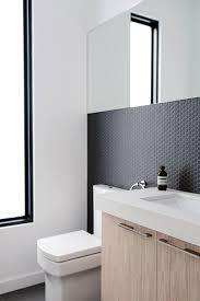 matte black penny tiles on the bathroom walls