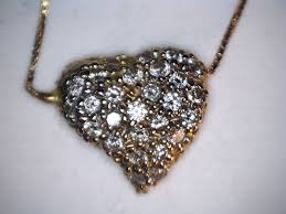 14 kt yellow gold heart shaped pendant set with diamonds in pavé on a 41 1