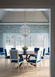 dining room with pea blue velvet dining chairs