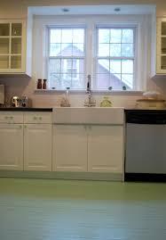 Above Kitchen Sink Lighting Dimly Charming Lit With Above Kitchen Sink Lighting In Between The