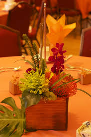 centerpiece in a wooden box with tropical details. $50.00