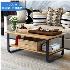 simple wooden brown ikea living room sofa coffee table desk