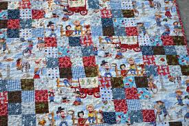 Little Scraps of Happiness: Cowboy Quilt & Fabric is Lil' Cowpokes and Lil' Cowgirl by Michael Miller. And there are  some other fabrics from my stash thrown in there. It's kinda busy, but I  like it. Adamdwight.com