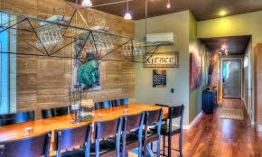lighting fixture over dining table with wine glass