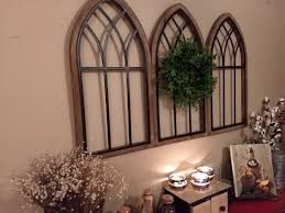 This wall décor presents a farmhouse twist on the windowpane wall decor trend. Farmhouse Wall Decor Wreath And Window Rustic Wood Metal Cathedral Arch Church Windows Kitchen Wall Decor Dinning Room Wall Decor In 2021 Farmhouse Wall Decor Arched Wall Decor Dinning Room