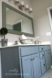 pretty distressed bathroom vanity makeover with latex paint one