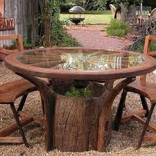 furniture made from tree trunks. table made from tree trunk stump wagon wheel and glass must have furniture trunks