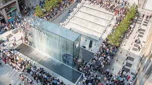 foster partners creates dramatic glass fountain for apple s new milan