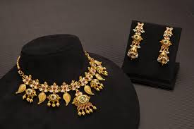 Gold Jadtar Set Design Suresh Zaveri