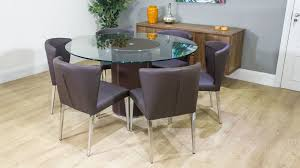 large round 6 seater dining and brown dining chairs
