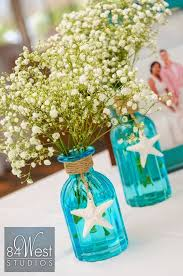 Wedding Dress for Love Beautiful beach themed centerpiece using blue mason  jars, starfish and baby's breath. Perfect for a beach bridal shower or  wedding.