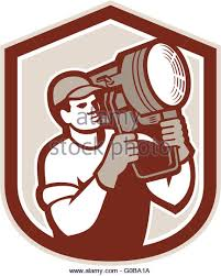 lighting technician. electrical lighting technician carry spotlight shield stock image