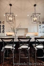 kitchen island chandelier over kitchen island white shaker style kitchen with cross mullions mini chandelier