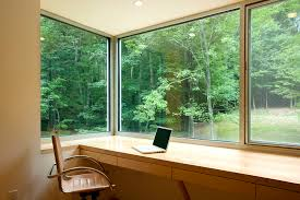 forest house in spring example of a trendy home office design in dc metro with a amazing large office corner