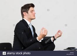 how to meditate in office. How To Meditate In Office. Meditation Young Businessman Doing At Desk Office 3