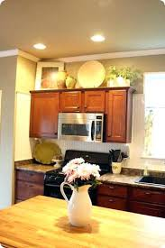 decorating tops of kitchen cabinets. Plain Decorating Decorating Above Kitchen Cabinets Cabinet Decor Tips For Cupboard Top Paper Throughout Tops Of S
