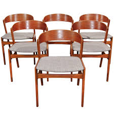 ribbon back teak dining chairs by dux