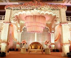 The grand chandelier and the pillars add so much character to the stage and  is a great theme for your wedding reception stage.