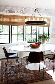 modern dining table centerpieces. A Modern Dining Space With Industrial Chandelier And Dark Clouds On The Wallpapered Accent Wall. Table Centerpieces E