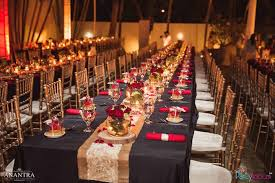 Party tables lined with gold runners and chiavari chairs from a Rustic  Vintage 21st birthday Party