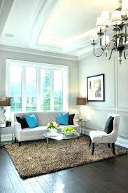 matching coffee and end tables a small living room in white beige with splash glass table