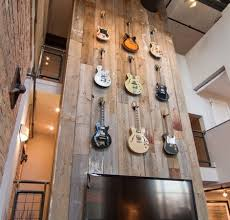 reclaimed wood provides a great backdrop for this display of guitars