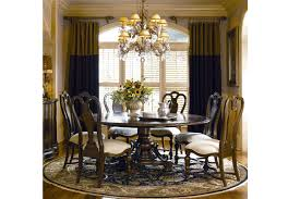 shaped rug under dining room table