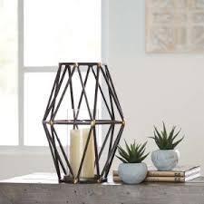 metal design furniture. Signature Design By Ashley DEVO Series Black And G. Metal Design Furniture