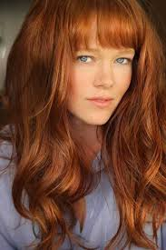 copper haircut with bangs for curly hair