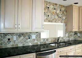 antiqued travertine backsplash with black granite countertop