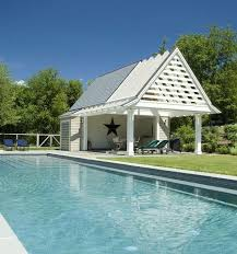 Beach style and contemporary charm rolled into one inside the pool
