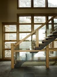 Trendy wooden open and glass railing staircase photo in Salt Lake City
