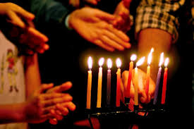 photo istock chameleonseye photo istock chameleonseye when lighting the hanukkah menorah