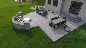 backyard fire pit with seat wall and paver patio oasis landscapes
