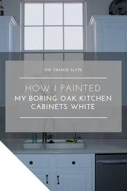 painting oak cabinets whiteHow I Painted My Boring Oak Kitchen Cabinets White  The Orange Slate