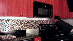 Bathroom Red Wooden Kitchen Cabinet With Peel And Stick Mosaic Tile
