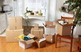 moving boxes packed in new house new apartment background