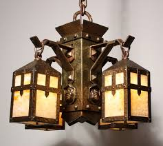 unusual antique arts crafts figural chandelier with monks heads and decorations 19