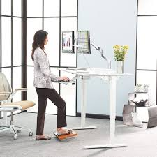 the newest trend in the american office is the standing desk which is supposedly an improvement over the conventional cubicle arrangement