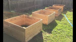 how to make a raised garden bed with pallet wood diy daddy