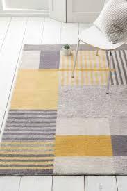 next block rug yellow